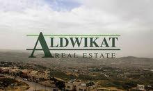 ارض للبيع في منطقة الفحيص (الحمر) , مساحة الارض 1335م