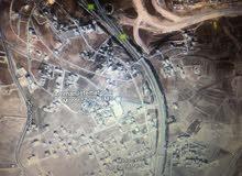 ارض للبيع على شارع المطار قرب وزاره الخارجية مساحة 2 دونم واجهة 70 متر تصلح لعدة مشاريع معرض سيارات