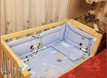 سرير اطفال مقاس متر في 60 بالجوانب
