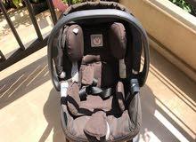 peg-pérégo brand color brown car seat 1st age