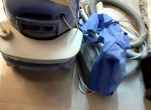 مكنسة كهربائية وغسالة فرش