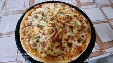 بيتزا كبيرة 600 جنيه وكلزوني 220