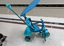 toddler tricycle with handle and sun protection.