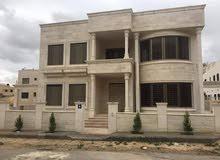 Daheit Al Rasheed neighborhood Amman city - 550 sqm house for sale