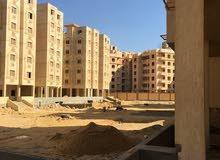 للبيع شقة نصف تشطيب مع مكان لسيارة بالجراج بالقاهرة الجديدة
