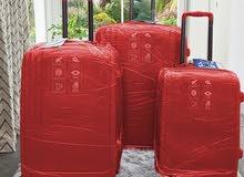 مجموعة الوان من حقائب السفر