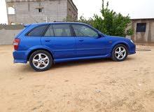 مازدا 323 2004
