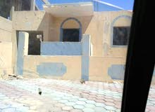 منزل للبيع بالسابعه حرف أ امام المسجد و بجوار الوحده الصحيه والمول خالص طوب احمر