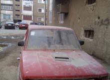 سيارة 127حمراء اللون باسيوط المدينه