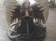 تمثال الملاك الداعي