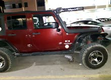 Manual Maroon Jeep 2009 for sale