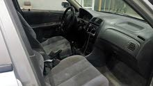 Mazda 323 1999 For sale - Grey color