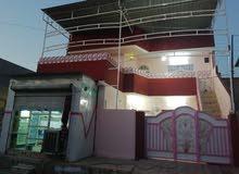 بيت طابقين مساحة 200 متر للبيع الموقع الموصل الرفاق قرب جامع الروضة المحمديه قرب