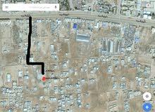 قطعة ارض سكنيه مساحته 500 متر تطل على شارعين في منطقة ال7