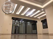 شقة دوبلكس جديدة اخير مع روف للبيع ضاحية النخيل 200م تشطيبات فاخره واطلالة جميلة