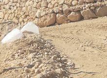 بناء سلاسل حجر مع كحله وصبه وشيك استصلاح الأراضي