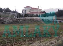 ارض مميزة جدا  830 م سكن ب خاص على شارعين على طريق المطار بجانب قصر البشارات