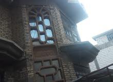 بيت تجاري على شارع عام في بابل حي الاكرمين  المساحة225