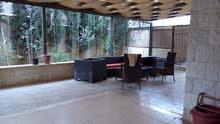 شقة شبة ارضي مع حديقة 150 م وترس خارجي  وكراج في أجمل مواقع عمان /بالقرب من جامعة البترا