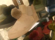أحذية نسائية وبناتي ورجالي