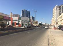 ## ارض سكني استثمارى ( ارضي + 4 ) ##  بموقع مميز جداً  - منطقة البستان - بإمارة عجمان KBH 33