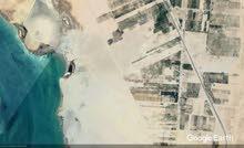 أرض 20 فدان شرق السويس مميزة مطله على البحيرات المره
