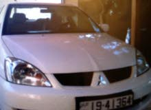 متسوبيشي GLX لون ابيض موديل 2011 ماتور 1600 cc اصلي