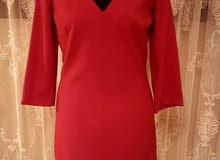 فستان  احمر  جديد  غير ملبوس  بالتيكت متاعه