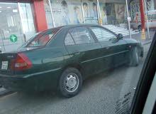 Green Mitsubishi Lancer 1999 for sale
