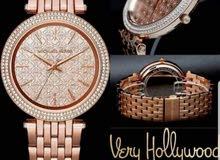 ساعة مايكل كورس الاصلية كفالة سنتين مع علبتها سعرها الاصلي 83