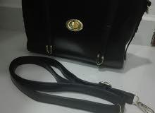 a Hand Bags that's condition is Used is for sale