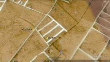 أرض 605 متر على شارعين وقريبة من قطران ش المطبات بمنطقة أم مبروكة