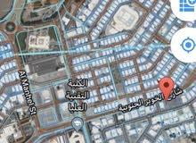ارض سكنية الخوير اول خط الكلية التقنية العليا موقع مميز حيوي