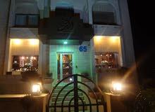 مبنى تنظيم مكاتب للأيجار  في الحي التجاري و شريان منطقة الشميساني