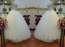 بدلة زفاف بيضا