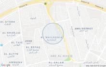 بغداد . الكرخ . حي العامل . الملحانية على الشارع التجاري للمنطقة