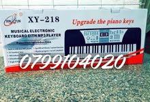بيانو اورج تعليمي فخم جديد بالكرتونه يعمل ع الكهربا والبطاريه 51 مفتاح
