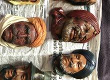 مجموعة من الوجوه تمثل اشخاص من حول العالم ، صناعة بريطانية متقنه الصنع تم الشراء من بريطانيا