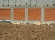 صناعة الأبواب السحابة بأنواعها وبناء وتشييد الهناجر وجسور المشاه