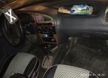 سيارة لانوس وان كامله اوتومتيك موديل 99 رخصه سنة فابريكه دواخل