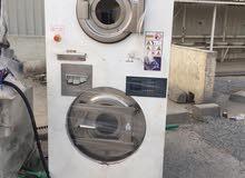 غسالة للبيع 10 كيلو مع مجفف ب 850 نظيفه جدا تصلح لمحلات الغسيل الجاف