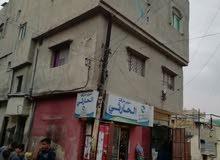 بيت في مخيم البقعة للبيع قرب جامع نابلس على شارعين