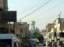 مجمع تجاري للبيع في الزرقاء حي الأمير محمد مؤجر بالكامل