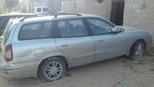 داو نبيرا 2002 عائلية توماتك فيها برنزيني السيارة نضيفة والمازدة الكحلة للبيع فيها قو