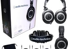 Audio Technica M50x professional headset with a stand