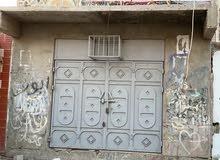 للبيع شقة مع محل في خورمكسر ب250 الف سعودي صافي