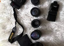 كاميرا نيكون + عدسات