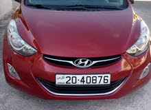 Maroon Hyundai Avante 2011 for sale
