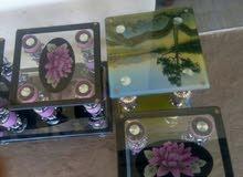 ترابيز زجاجية مستوردة جديدة راقية ألوانها عسلية وبنفسجيةوفي شكل لوحات فنية تحفة