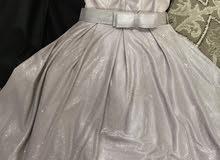 فستان لميع وردي للبيع استعمال مرة واحدة.